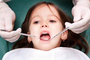 Child receiving pediatric dentistry